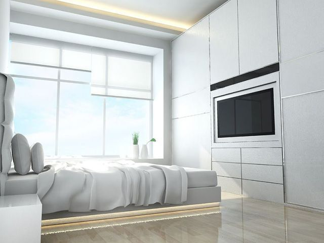 If you're limited on space but still need a place for clothing and a television, check this design out. This room has built in dressers, saving some floor space. It also has the television built into the wall. The entire bedroom is white, with the exception of the glossy hardwood flooring, which allows the sunlight to bounce off, eliminating the need for lamps on the nightstands. If you like bright rooms, this is one for you. #MinimalistBedroom