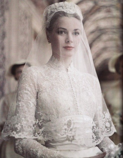 Princess Grace Kelley Wedding Dress made of chiffon and lace; with tightly accentuated waist; with overlays, embellishments, and embroidery.