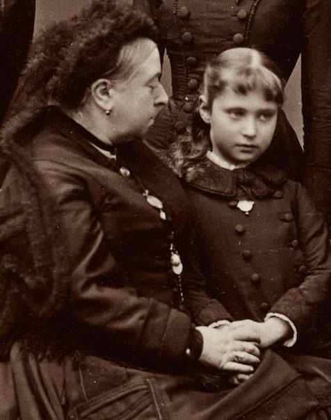 The last Empress of Russia as a young girl sitting with her Grandmother, Queen Victoria, who adored her -as clearly seen here.