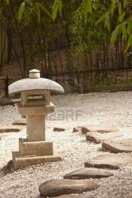 Old Japanese stone lantern in a garden. Stock Photo