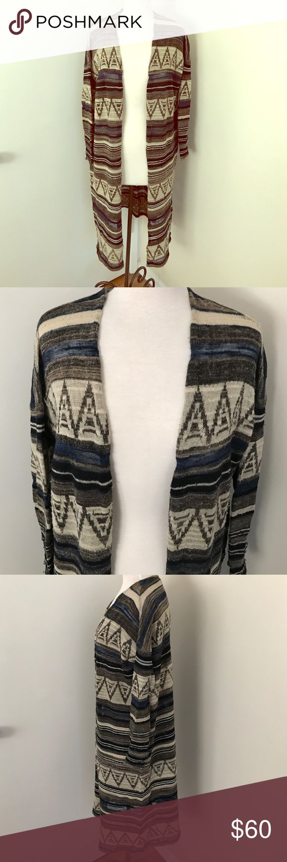 Free People Navajo Print Cardigan Sweater XS Super cute and comfy Free People Navajo print Cardigan sweater. 59% acrylic 26% wool 8% nylon 3% alpaca 3% rayon 1% linen. Size XS. Good used condition with piling from wear Free People Sweaters Cardigans