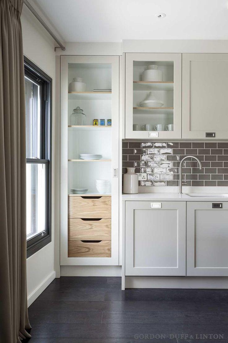 Bespoke shaker-style kitchen with green ceramic metro tile. Grey pendant lamp over dining table. #GD&LBespoke