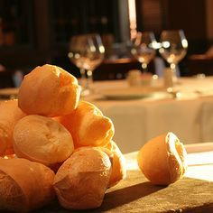 Fogo Pão de Queijo Recipe: Pão de Queijo, also known as cheesy bread, is both a popular snack and breakfast food in Brazil. Warm, soft cheesy bread rolls are served throughout an entire meal, and this irresistible recipe from São Paulo is both easy-to-make and entirely unmissable. Made with sweet and sour yucca flour and Parmesan cheese, these rolls are naturally gluten-free.