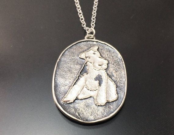 Handmade Gift Ideas DOUG Terrier pendant approximately 25mm wide x 33mm high available in Oxidised Silver or Brass with textured reverse side.  There are 2 choices of chain to choose from.  1) Silver 1.6mm extendable belcher style chain 16-18/40-45cm 2) Silver 1.6mm extendable belcher style chain 18-20/45-50cm  Please note that each pendant will vary slightly with how it looks, as it is custom made using the lost wax casting process and hand finished in the studio. A patina is added...
