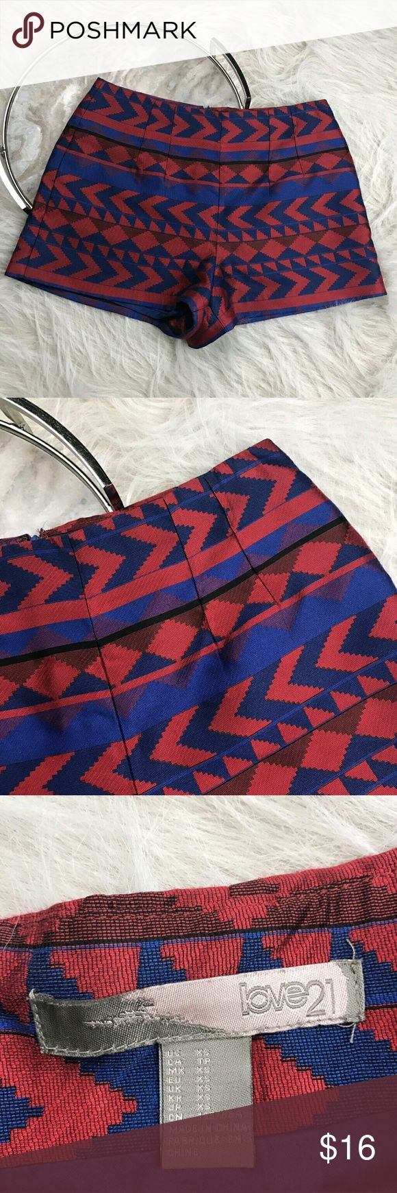 "Forever 21 Jacquard Aztec Shorts Forever 21 aztec print red blue high waist jacquard shorts. Womens size XS. Gently used, without flaws. See pictures for details.  Waist laying flat - 14"" Rise - 11"" Inseam - 2.5""  Inventory 04252017 Forever 21 Shorts"