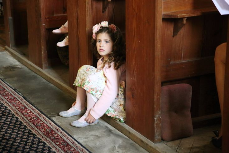 child in pew at natural essex wedding