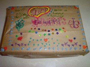 This shoebox project for the homeless can help your troop earn five Daisy petals at once.