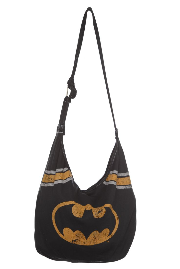 This hobo bag features a distressed Batman logo and stripes. Interior has pouch pockets and a snap button closure. I love it more than life