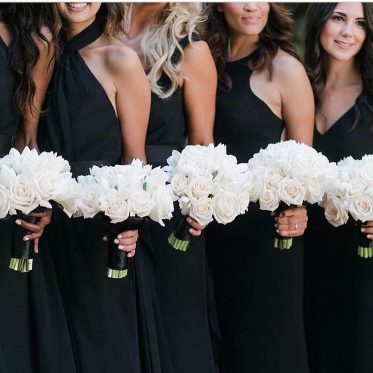 Loving these black bridesmaid dresses with white bouquets.