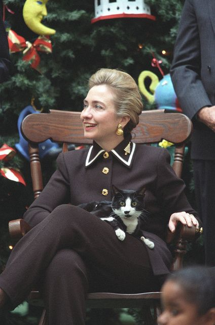 Hillary Rodham Clinton with a cat on her lap (a very startled looking cat and I have just realised it's probably Socks).