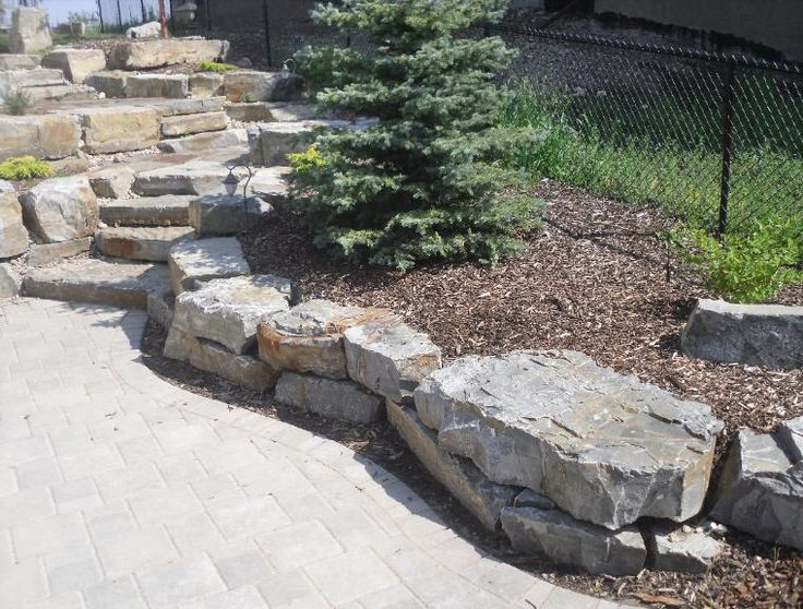 Stack Moyie Rust retaining wall blocks. Natural Rustic steps installed