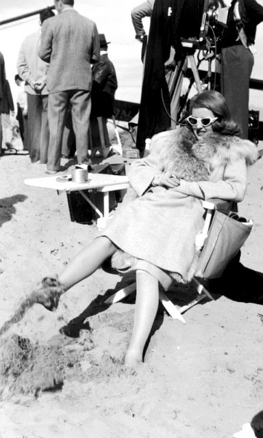 Bette Davis between takes the sand between her toes!