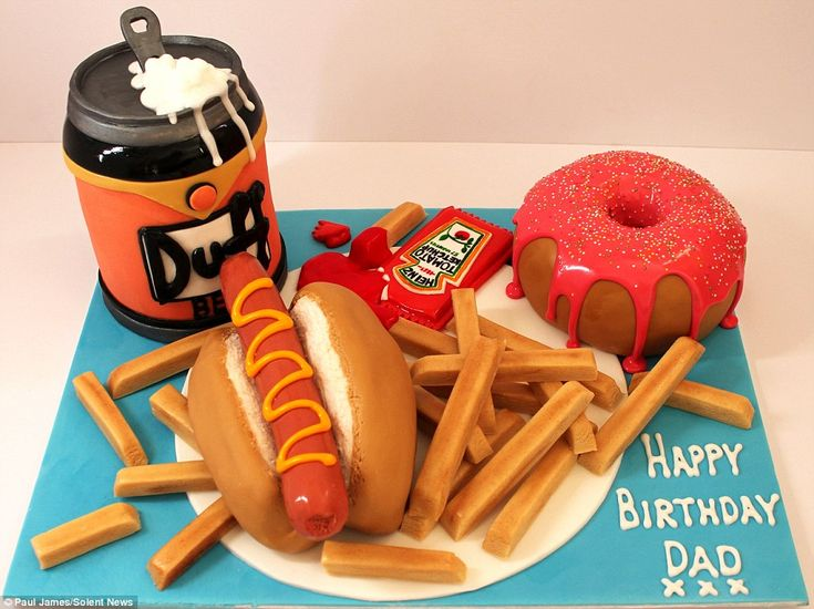 One father clearly has an appetite for unhealthy food with a cake in the shape of a hot dog, chips, beer and a glazed doughnut for dessert