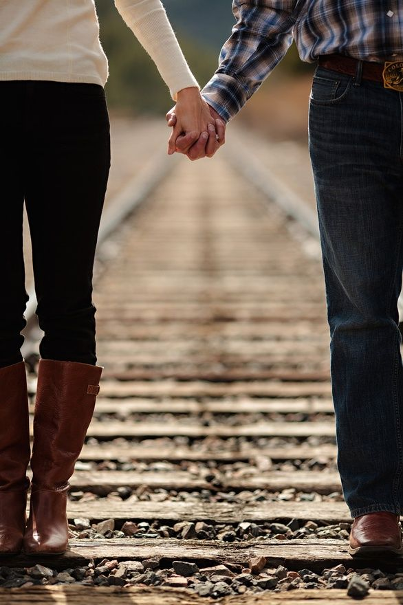 I like the symbolism of the railroad tracks - like a path that the couple is on together