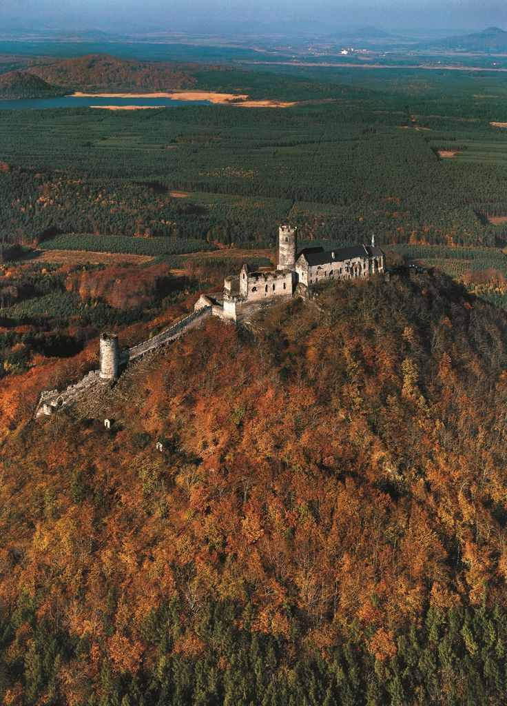 "The Bezděz castle, nicknamed the ""King of Czech Castles"" has been preserved in a unique Gothic style. From the towers and battlements, one may admire the peaks of České středohoří, Lužice Mountains and the majestic mountain of Ještěd. The castle was founded by the Czech King Ottokar II and was a favourite place of Emperor Charles IV."