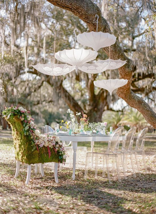 This bridal shower was inspired by Spring florals with vintage touches like this awesome hanging umbrella decor idea.