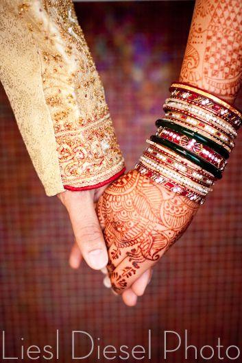 bridal henna tattoo bride groom hold hands