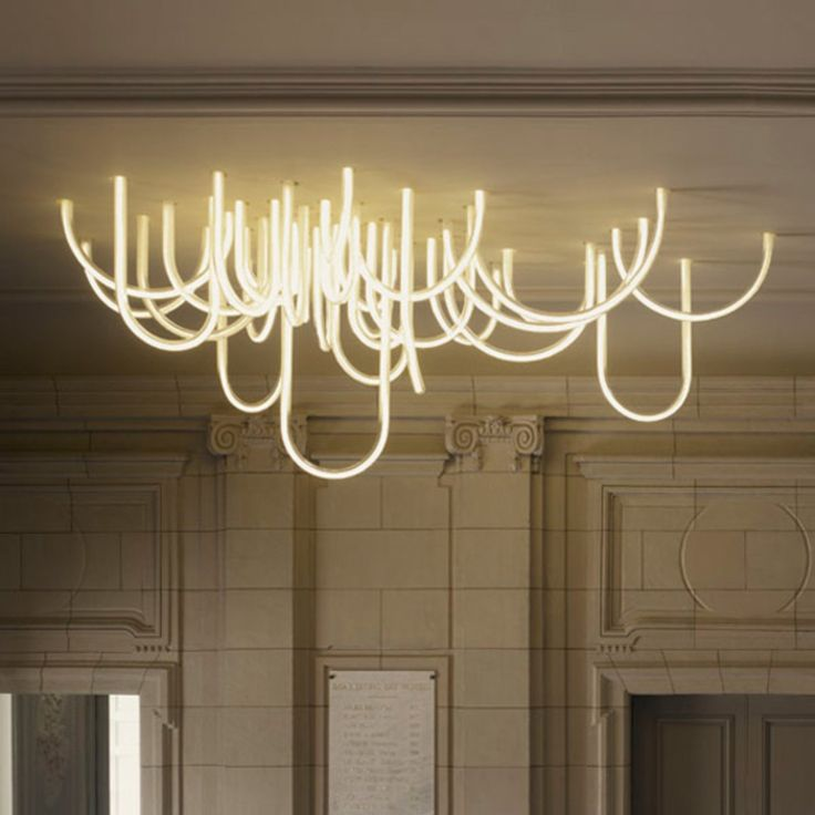 "Les Cordes, An LED Chandelier That Mimics Dangling ""Ropes"" Of Light - Explore, Collect and Source architecture"