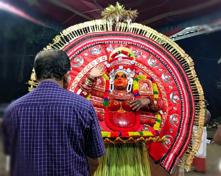 Please vote if you like this image of theyyam.  Click on the link and cast vote