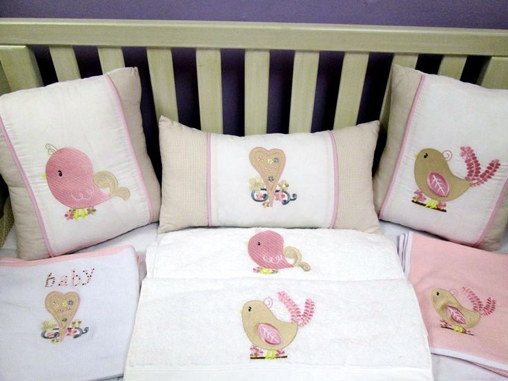 Chirpy quilt set: Beautifully embroided cot set handmade from the best cottons. Set includes: cot bumper, quilt, mini scatter and fitted sheet (made to fit mattress 1.3m X 66cm) orders@borderbout...  Extra scatters and products available at request.