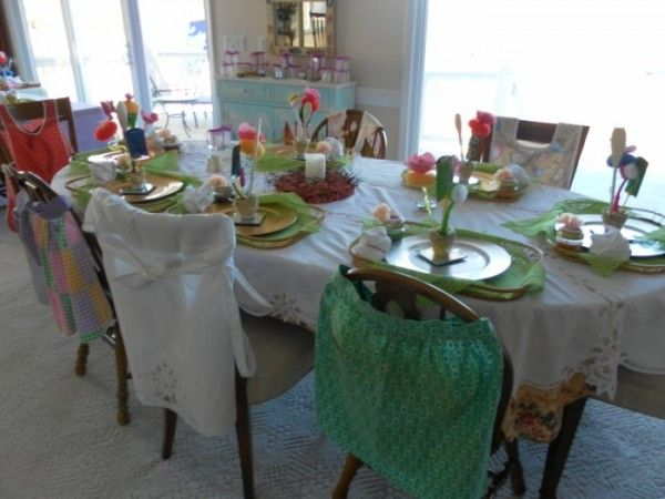 Apron Theme Ideas.  This is from a bridal shower.  Love how they put the aprons on the chairs.