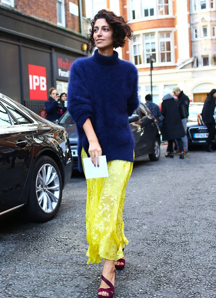 Yasmin Sewell in a turtleneck sweater, yellow maxi skirt, and heels