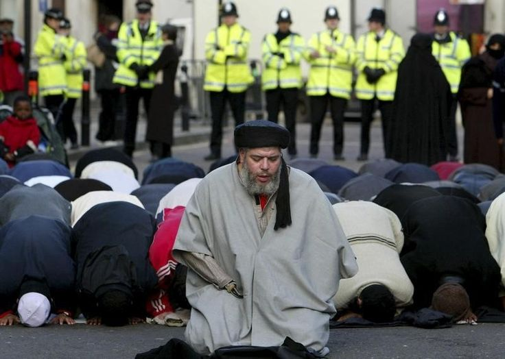 """1/8/15 - REUTERS  Islamic cleric sentenced in New York to life in prison for terrorism. Muslim cleric, Abu Hamza al-Masri, is seen leading prayers...The defense argued that Masri's disability merited special considerations including that he be sent to a prison medical facility. """"We are not asking for unwarranted leniency, we are merely asking that justice be tempered with mercy,"""""""
