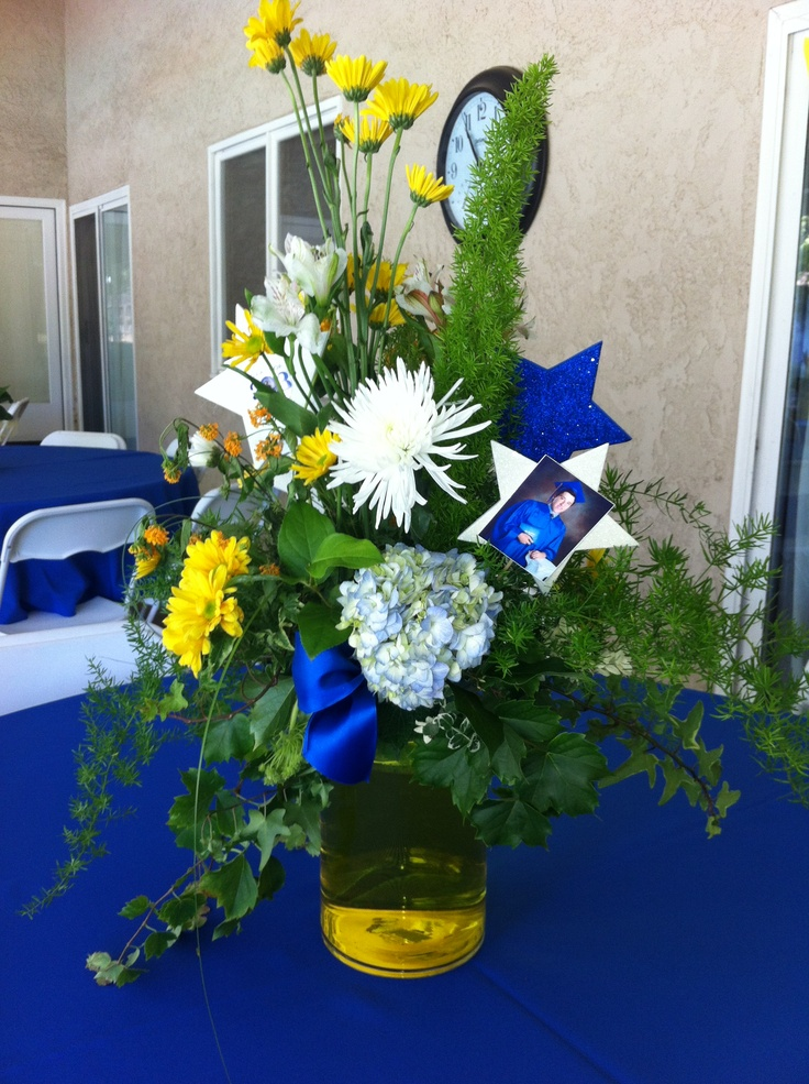 Graduation centerpiece with fresh flowers added in dye