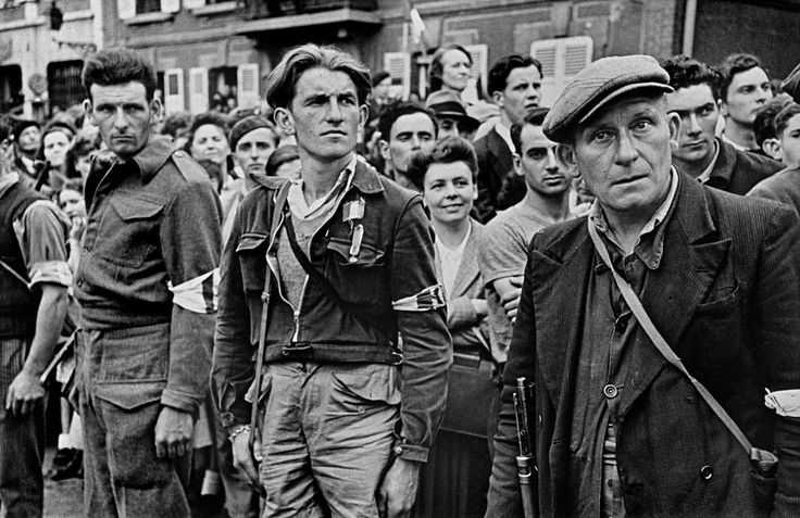 Chartres. August 23, 1944. French Resistance fighters listening to Gen. De Gaulle proclaim the liberation of the town//Robert Capa