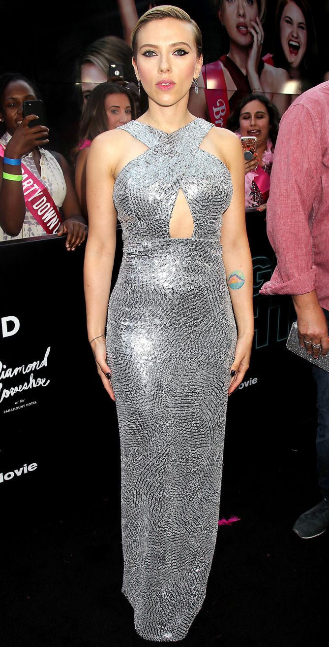 Scarlett Johansson is wearing a silver sequin Michael Kors Collection cutout column dress. Scarlett sparkles and shines! This dress fits her like a glove!