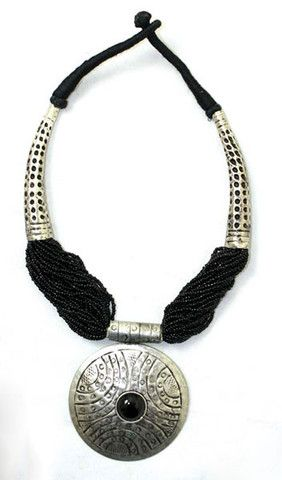 The detail in the design of this necklace is very unique. Tiny black beads connect to textured silver with a cotton threaded closure at back. If you like this, you should also check out the matching e