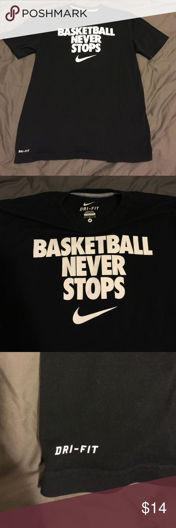 Nike Basketball men's medium Dri fit black white Men's basketball size medium, Nike Dri fit t shirt. From the famous lock out, brings this basketball never stops motto. Exclusive and historic shirt. Worn and washed 4x. Still a lot of use in this shirt. Nike Shirts Tees - Short Sleeve