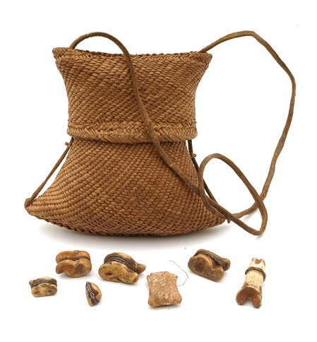 Africa   Woven pouch containing divination objects ~ 'thilolo' ~ from the Tonga people of Mozambique   18th century   Bone, shell, vegetable fiber, iron and leather