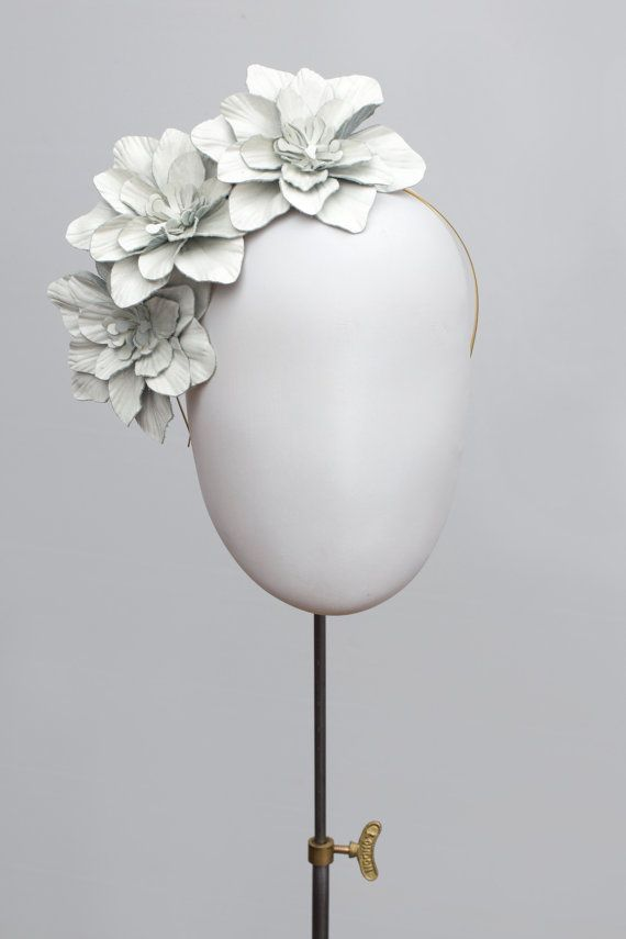 Manon is a striking headpiece consisting of three camellia flowers made from patent leather. https://www.etsy.com/uk/listing/280978394/flower-headpiece-white-leather-camellia 400