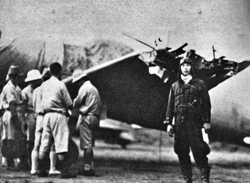 IJNAF Pilot posing with his Damaged Zero fighter from the aircraft Carrier Kaga, South Pacific 1942.