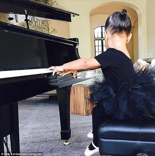 Kim Kardashian proudly shows off North's musical skills #dailymail