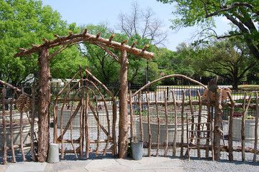 rustic arbor and fence made from salvaged tree prunings and cleared saplings