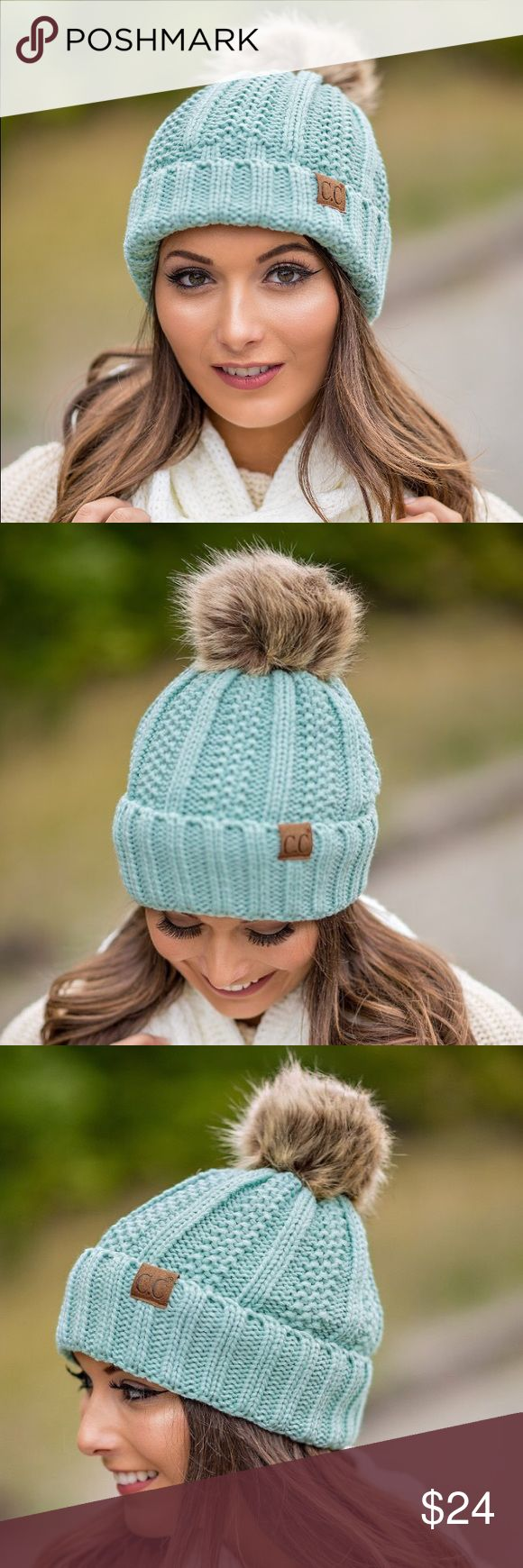 Mint Pom Knitted Beanie This stunning mint knit beanie is perfect for any chilly day. With a soft knit, blanket lined inside, stylish faux fur pom pom and signature suede CC label you'll be stylish and warm all season long   Color: Mint  75% ACRYLIC 25% POLYESTER  Blanket Lined  Faux Fur Pom Pom C&C California Accessories Hats