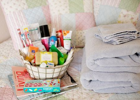Guest room basket. Full of handy things like Advil, feminine products, mini first aid kit and Downy Wrinkle Releaser. What a great idea!