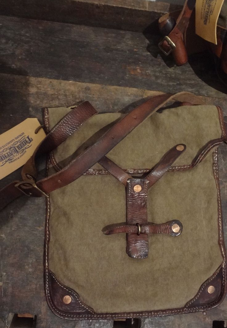shoulder bag ..otter waxed canvas with veg tanning thick leather.