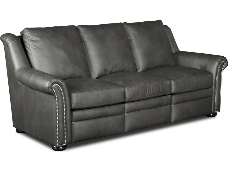 Stay true to your elegant and sophisticated style with this leather reclining sofa disguised as a stationary model. The wooden feet and traditional rolled arm and back design look just like an impeccably chic stationary sofa, but it turns into a recliner with the touch of a button. Both power and manual models feature release buttons built into the inside of the sofa arm, keeping your look chic and saving more space than a clunky handle mechanism.