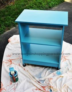Recycled microwave cart turned book case