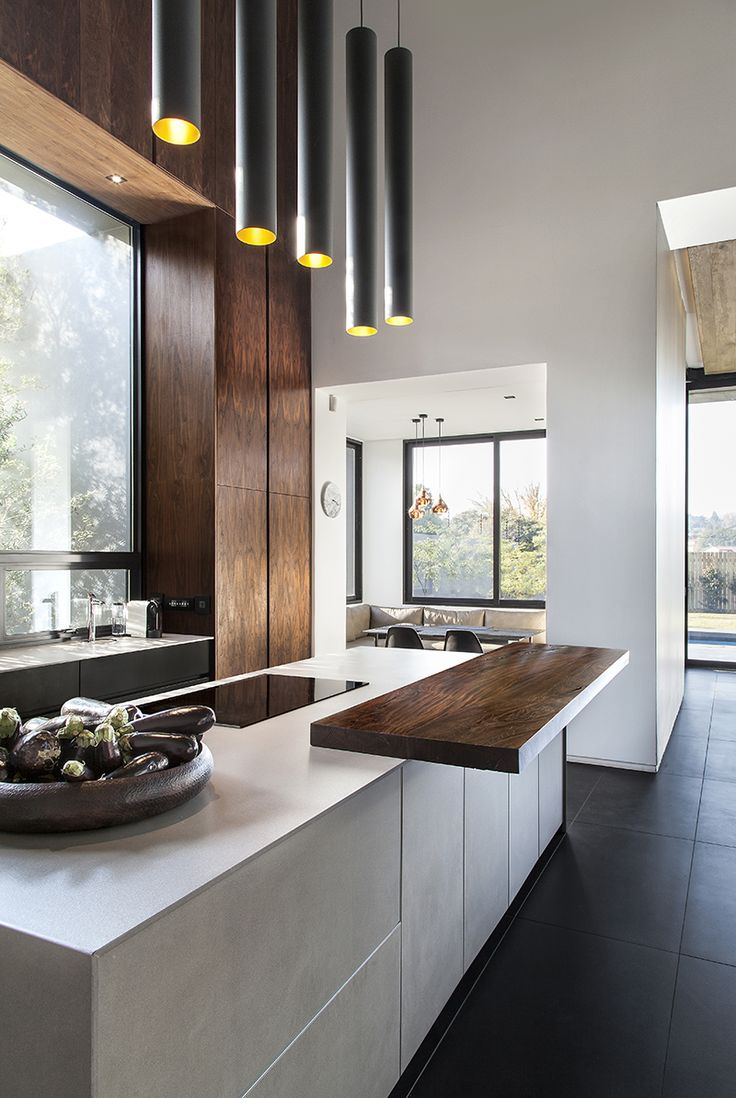 Kitchen trends. Mix modern and raw. Handle-less units. Dark floors. The industrial look. Clutter-free worktops. Clever storage solutions. Kitchen organization. Monochrome tones. Copper accents. Mix old and new.