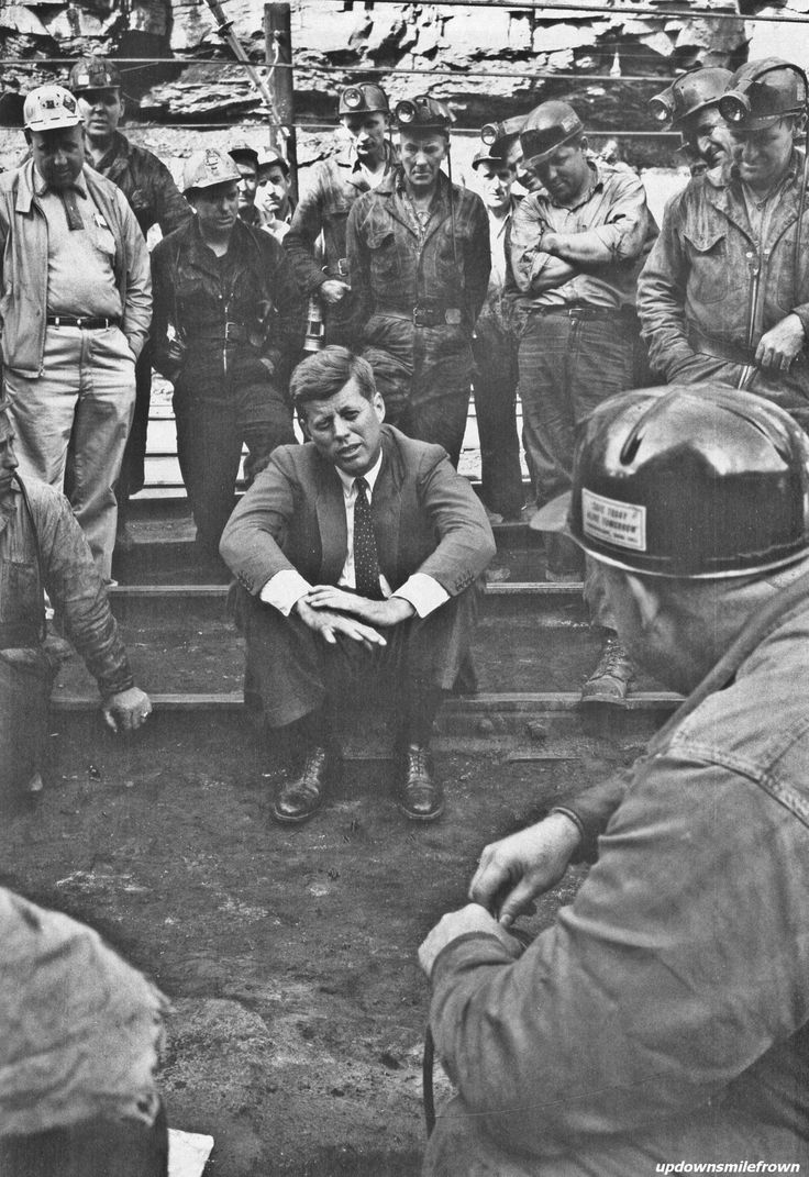 updownsmilefrown:    During the Democratic primary campaign, John F. Kennedy talks about the economic conditions with West Virginia coal miners. His victory in a large Protestant state showed his Catholicism would not be a major problem elsewhere in the election, 1960  by Hank Walker