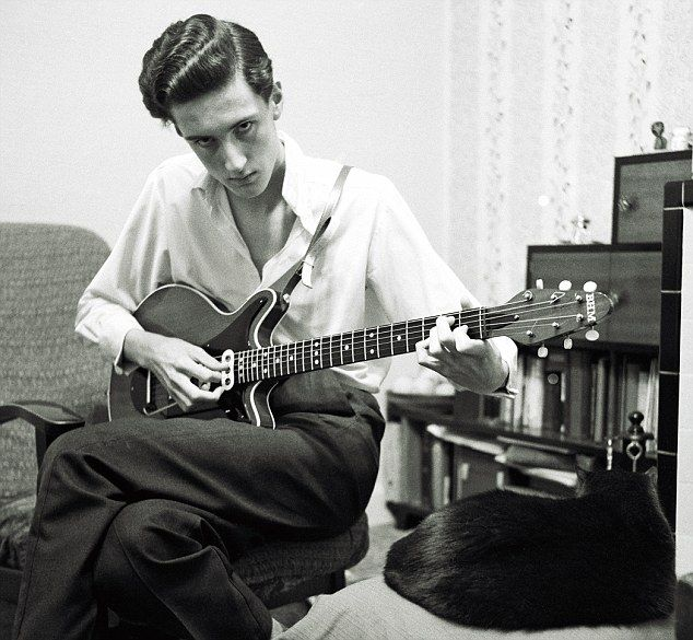 Brian with the Red Special at his Feltham home in 1963. The guitar was made 'in about two years of spare moments, all done with hand tools – planes, chisels and saws, and a lot of sandpaper'