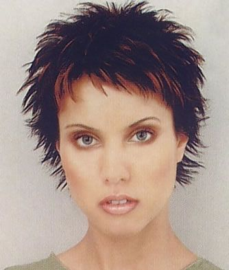 Short and spunky, this short spiky hairstyle adds height and width to the style and the narrow fringe frames the face.