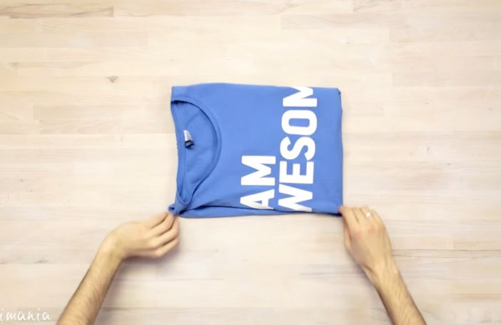 Fold a T-shirt easier and faster than ever.! Chinese facts. Awesome. So much easier.