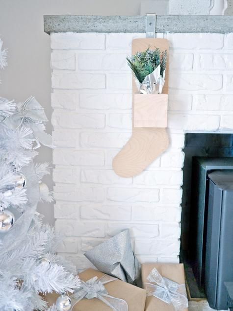 These handmade plywood stockings from blogger Erin Loechner reflect a Scandinavian aesthetic and the wood subtly warms up the white mantel. Best of all? They're magnetic, so they can be removed and filled with ease.
