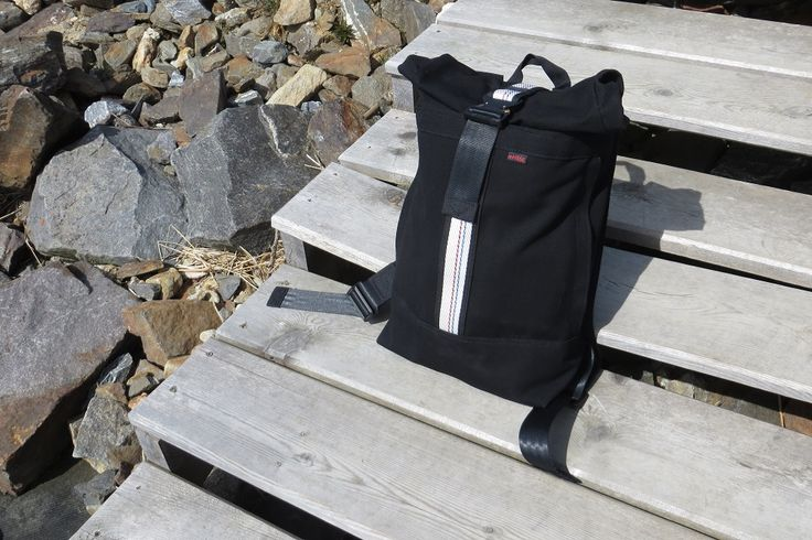 Canvas rolltop backpack with cobra buckle and detail from firehose.