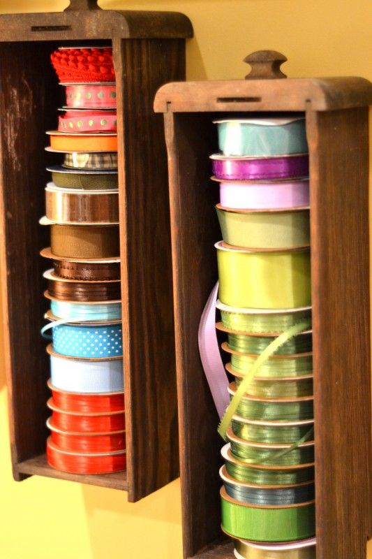Antique sewing machine drawers repurposed as ribbon holders.